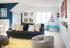 Colorful Playroom Decor ~ white walls really make the bright pillows and accessories pop in this fun room.