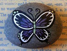 Rocks -HE SELLS-SHE SELLS... Pretty butterfly!