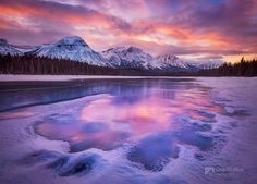 Sunset along a frozen portion of the Athabasca River in Jasper National Park.