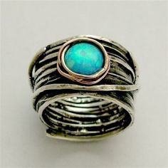 turquoise ring This design is extraordinary.  Flow, patina, and emphasis in a quaint stone.  K.W.