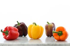 Classic stuffed peppers with rice, ground beef, and a healthy rainbow of sweet red, yellow and orange bell peppers makes the best easy dinner idea any night of the week. Ever since I was a starry eyed pre-teen, I've been a fan of drawing rainbows. Now I eat them. But as a kid, I wrinkled …