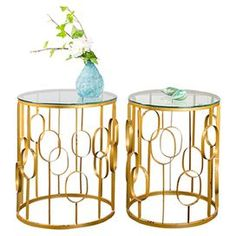 """Set of two glass-topped side tables with openwork metal bases.      Product: Small and large side table Construction Material: Glass and metal   Color: Gold   Dimensions: Small: 20"""" H x 16"""" Diameter Large: 23"""" H x 19"""" Diameter"""