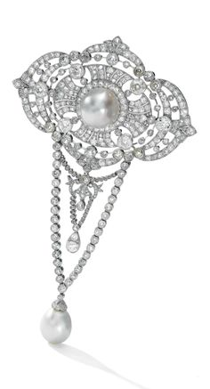 A Belle Epoque natural pearl and diamond brooch, circa 1910. Set to the centre with a part-drilled button-shaped natural pearl measuring approximately 14.4 x 14.8 x 12.6mm, suspending a part-drilled drop-shaped natural pearl measuring approximately 11.8 x 12.6 x 14.5mm, the plaque design millegrain-set with circular-cut and rose diamonds. #BelleÉpoque
