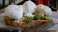 Poached eggs, on a bed of toast with avocado spread, gourmet lettuce, danish feta and a drizzle of balsamic glaze.