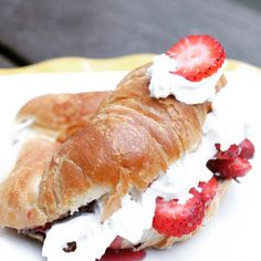 Whipped cream and strawberries on croissants
