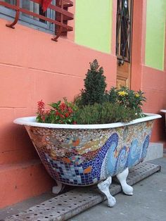 a good idea for repurposing / recycling an old tub for the garden...