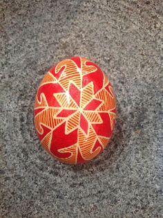 Combination of yellow and red is awesome on this egg.  Real Chicken Egg hollowed out and dyed with wax resist technique – Tamm's Marketplace