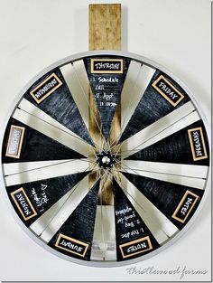 Keep track of your weekly activities with this adorable bicycle wheel chalkboard calendar.  Get the tutorial at Thistlewood Farms.   - CountryLiving.com