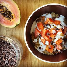 It's a Friday treat with papaya / paw paw porridge. The bitter crunch of cacao nibs is lovely with the sweet fruit, a swirl of @coconutcollab natural yoghurt and a little scattering of coconut flakes. This morning's porridge base is a mix of millet and gf oats. Yum yum!  #porridgediaries #porridge #oatmeal #breakfast #healthy #glutenfree #vegan #vegetarian #hbloggers #coconut #papaya