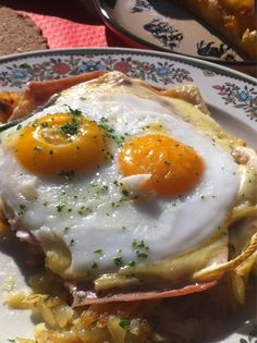 Swiss specialty: roesti with gruyere cheese ham and sunny side eggs.