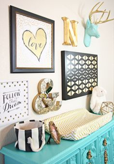 Gold Nursery Design - we LOVE the turquoise accents! Gold chevron nursery with #cadenlane - that collage wall is amazing and all from #hobbylobby