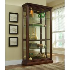 Display prized items and cherished collections in all their splendid glory with this mirror-backed Curio with a medium Eden House Brown finish from Pulaski. Tall and handsome silhouette features classic framed moldings and a sliding door with lock. Glass Curio Cabinets, Glass Shelves, Display Shelves, Display Cabinets, China Cabinets, Book Shelves, Display Case, Display Ideas, Sliding Glass Door