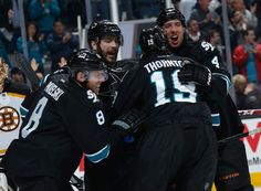 San Jose Sharks forwards Joe Thornton, Joe Pavelski and defensemen Brent Burns and Brenden Dillon celebrate Pavelski's goal (Dec. 4, 2014).