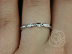 This gorgeous design is a spin off of infinity rings. This is designed so that it will sit fairly close to the straight engagement ring bands. It designed low so that it can sit comfortably on the finger and can easily be stacked with any of our other bands.  All stones used are only premium cut, fairly traded, and/or conflict-free! Our diamonds are always natural NEVER treated or enhanced for better color or clarity. Our products are only created with the finest of recycled metals. Rosa...