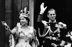 A Queen Greets Her Subjects  The newly-named Queen Elizabeth II and the Duke of Edinburgh wave from the balcony to the crowds around the gates of Buckingham Palace after the coronation on June 2, 1953. Norman Hartnell designed Elizabeth's coronation gown; she'd specifically requested that her gown be embroidered with the national flowers of each Commonwealth country.