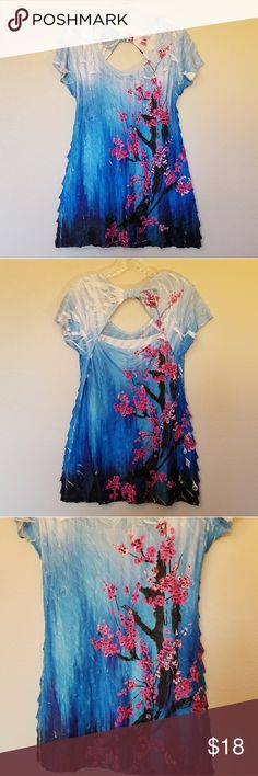 """Studio Y Cherry Blossom Top with Open Back Detail Short sleeve tunic style top with a little stretch. Open upper back with a faux knot. Hot Pink flowers on front have sparkle of rhinestones. Unfinished hem, slightly distressed look throughout top. Like new.   97% polyester, 3% spandex  Measurements (approx) laying flat: bust 17.5"""", length 30"""" Studio Y Tops Tunics"""
