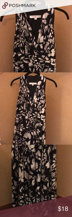 Black dress with leaf design Worn once!! Very flattering! Black dress, v-neck with empire waist. Midi length. Size 6 petite, but fits a size 4, average 6 or 8 just as well. Great date night dress! Evan Picone Dresses Midi