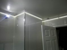 LED tape is concealed behind coving in this bathroom lighting project