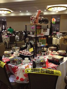 We have the best customers in the world.  Decorated charity table with tons of stuff purchased from House of the Dead