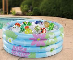 Inflatable pool to keep drinks cold - great idea for outdoor parties! Tropical party