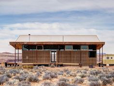 Design Build Bluff students from the Colorado Building Workshop at the University of Colorado Denver completed the Skow Residence in Bluff, UT made from parts of a kit home and straw bale.