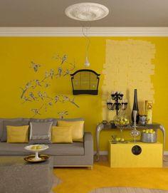 Die gelbe Farbe für die Wand dient als Hintergrund für die grauen Möbel