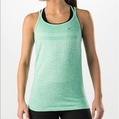 Nike Dry Fit Knit Tank Super cute green work out tank. Only worn a few times, it's just too big on me now :(. Super soft, flattering material, not clingy at all!  Classic superior Nike quality! Nike Tops Tank Tops