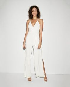 This jumpsuit is set to wow at parties and evenings on the town thanks to a sexy surplice v-neck trendy built-in belt and a dramatic open wide leg. Made from stretchy whisper-light fabric for a barely-there feel.