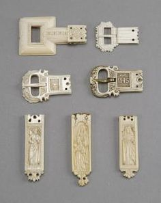 Belt pendants and buckles (Front): Private collection, London (in 2010) S/n Ivory;metal (remains of fittings);fabric (remains of belt) Height: 85mm (1); 53mm (2); 60mm (3); 65mm (4); 83mm (P1); 89mm (P2); 82mm (P3) Width: 50mm (1); 40mm (2); 41mm (3); 40mm (4); 23mm (P1); 24mm (P2); 22mm (P3) Depth: 10mm (1); 4mm (2); 9mm (3); 6mm (4); 5mm (P1-2); 4mm (P3) Buckle 1: rosette. Buckle 2: non figurative. Buckle 3: head of Christ; tracery; foliated decoration. Buckle 4: foliated decoration; IHS…