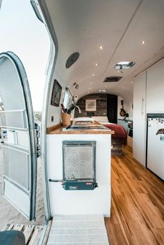 """The Dreamy DIY Remodel of a 1972 Airstream Home,""""The first thing people notice is how open and spacious it feels. That was a major priority when designing the layout."""" The couple was inspired by g. Airstream Decor, Airstream Living, Airstream Campers, Airstream Remodel, Airstream Renovation, Airstream Interior, Vintage Airstream, Vintage Campers, Vintage Trailers"""