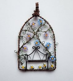 The Arbour wire wrapped and beaded garden seat and flowered vine pendant. £30.00, via Etsy.