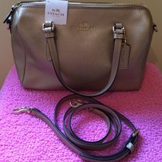 "NWT Coach Peyton Bennet mini Satchel Coach gold metallic leather Peyton Bennet mini satchel. Zip-top closure, fabric lining. Handles have 4.5 "" drop longer detachable strap for shoulder or cross body wear.  Bag is 9.5"" (L)  x 6.5"" (H) x 4.5"" (W) NWT  NO TRADES or PAYPAL Coach Bags Mini Bags"