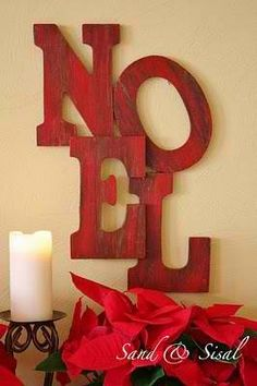 Noel: but silver glitter letters with a green wreath for the O