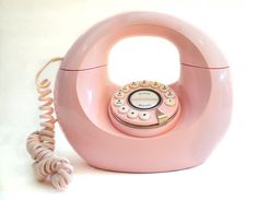 Vintage Retro Pink Handbag Donut Desk Phone A working desk phone from the 60s - 70s era. This is an authentic handbag phone, not a recent