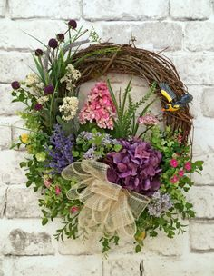Floral Spring Wreath, Summer Wreath, Front Door Wreath, Silk Floral Wreath, Grapevine Wreath, Outdoor Wreath, Etsy Wreath -  This beautiful floral wreath was handmade using a natural grapevine wreath base adorned with gorgeous array of purple, pink, yellow, and ivory silk flowers, lovely greenery, ivory bow, and a little yellow bird. This wreath would look wonderful above your mantel, on an interior wall, or on your front door! Its perfect for Spring and Summer.  • Already made and ready to…