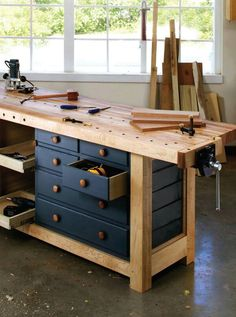 A stack of drawers and storage under a workbench has Shaker written all over it. By Glen D. Huey Pages: From the December 2007 issue Buy this issue now When I started work at Popular Woodworking magazine my workbench was a couple storage cabinet Woodworking Bench Plans, Woodworking Furniture, Woodworking Crafts, Woodworking Shop, Woodworking Techniques, Woodworking Jointer, Woodworking Apron, Youtube Woodworking, Woodworking Patterns