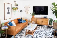 boho living room design - how to get this style. A bit too busy for me but love the feel of the room Light Brown Couch, Brown Leather Couch Living Room, Leather Couches, Boho Living Room, Living Room Sofa, Bohemian Living, Living Room Inspiration, Living Room Designs, Home Decor