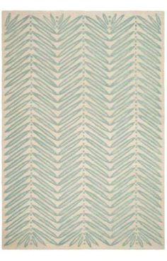 Chevron Leaves -- this one comes in a 6' round and might look nice in the Chamois Beige color for our dining room.