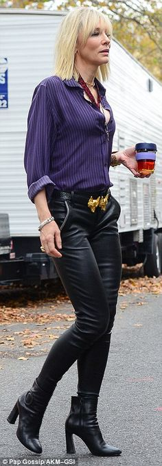 Vintage: In previous scenes Cate was seen wearing a purple striped long sleeved shirt and black leather pants that had been held up with a black belt with a large gold buckle