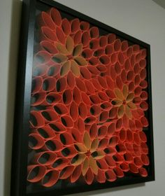 Painted toilet paper rolls and a hot glue gun used to create any image you want. Framed in a shadow box.