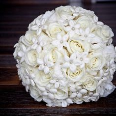 white roses and stephanotis blooms with pearls at the centers.