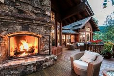 Rustic cabin porch with a beautiful fireplace! Cabin In The Woods, Log Cabin Homes, Log Cabins, Mountain Homes, Mountain Cabins, House With Porch, My Dream Home, Future House, Outdoor Living