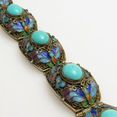 Chinese filigree turquoise bracelet has a butterfly design around beautiful blue turquoise stones. Gilt silver with push in clasp. Bracelet is 5/8 inch wide and about 6 5/8 inch long. A gorgeous almost antique bracelet, circa 1920s. Signed silver and in very good condition - one notable flaw: the safety catch is broken but clasp works well. I highly recommend having a jewelry add a new safety chain before wearing. I have priced to allow for that expense.  Find lots more vintage jewelry at…