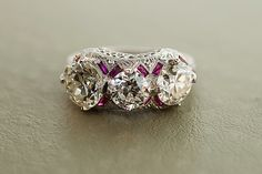 3 stone diamond engagement ring with ruby stone accents
