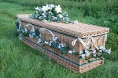 Traditional shape coffin in weatherbeaten gold willow and inlaid with woven green bands and green handles. http://www.wickerwillowcoffins.co.uk/
