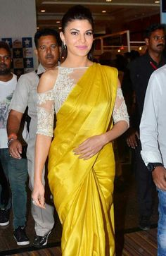 Best Contrast Blouse Ideas To Try With Yellow Saree.' In Pic: jacqueline fernandez in bright yellow with gorgeous lacy cut-out white saree blouse. Blouse Back Neck Designs, White Blouse Designs, Silk Saree Blouse Designs, Silk Sarees, Blouse Patterns, Saree Jacket Designs, Dress Designs, Saris, Indian Sarees