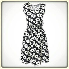 Bohemian Daisy dress Black and white daisy dress. Tag says its a large bit fits like a small. NWOT. My price is firm. Would best fit sizes 2/4. Dresses