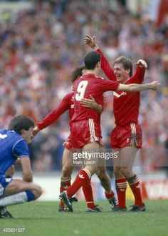May 1986 FA Cup Final Everton FC v Liverpool FC Ian Rush and Liverpool playermanager Kenny Dalglish celebrate victory at the final whistle Derek Mountfield sinks to his knees