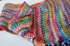 Beautiful scarf and LOVE that you don't have to weave in the ends! No pattern, but simple no-turn sc + ch stitch.