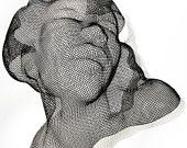 Hand formed sculptures in steel wire mesh by Eric Boyer.  $85.00